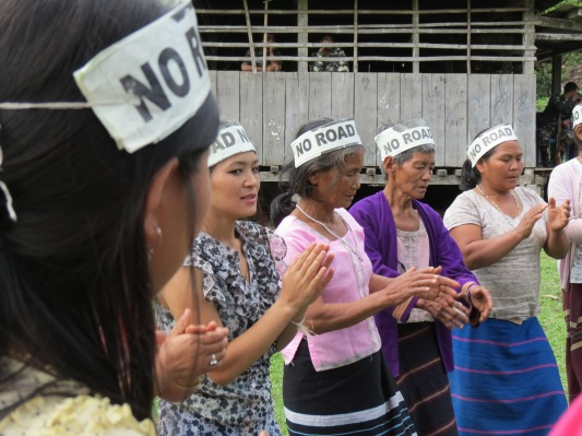Adi women doing the Ponung dance wearing the 'no road, no vote' caps.