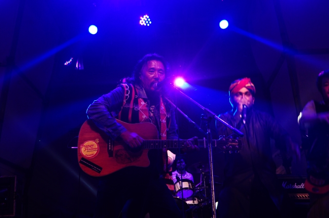 Rewben Mashangva (left) a Tangkhul Naga singer from the state of Manipur on stage with Rais Khan from Barmer Boys of Rajasthan in the west of country