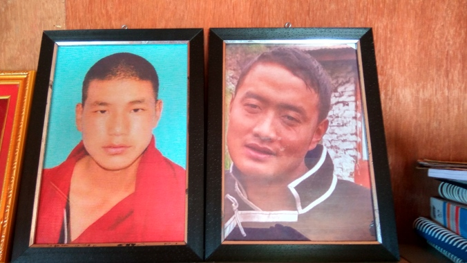 Portraits of Nyima Wangdi (left) and Tsering Tempa stand high on a shelf in Lobsang Gyatso's house
